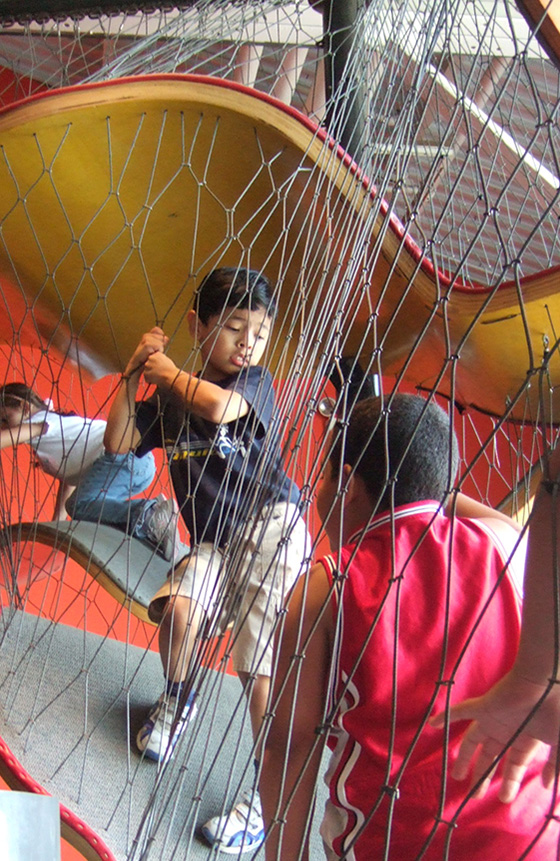 Children Traveling Through The Museums Netted Climbing Structure