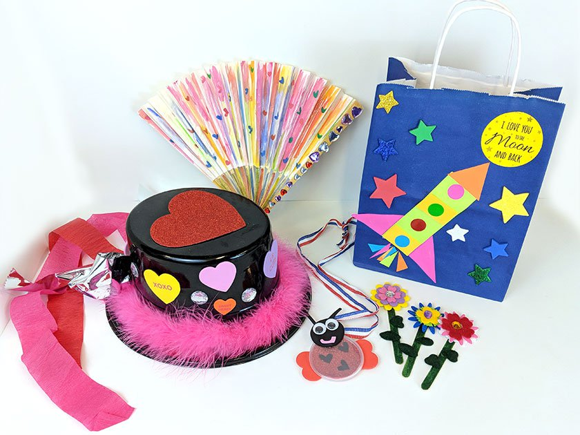 top hat and fan decorated with hearts, love bug necklace, blue bag with stars and felt flower crafts