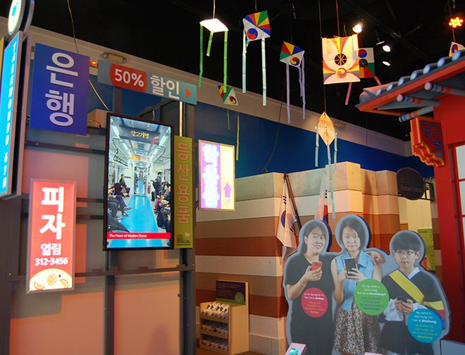 View of a town in Korea featuring children and different decorations.