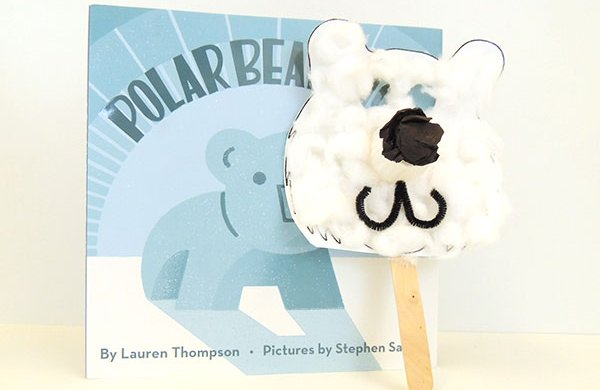 "The book ""Polar Bear"" with a crafted polar bear mask made of white cotton balls and paper."