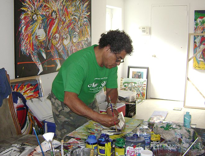 Artist painting on a canvas in his studio.