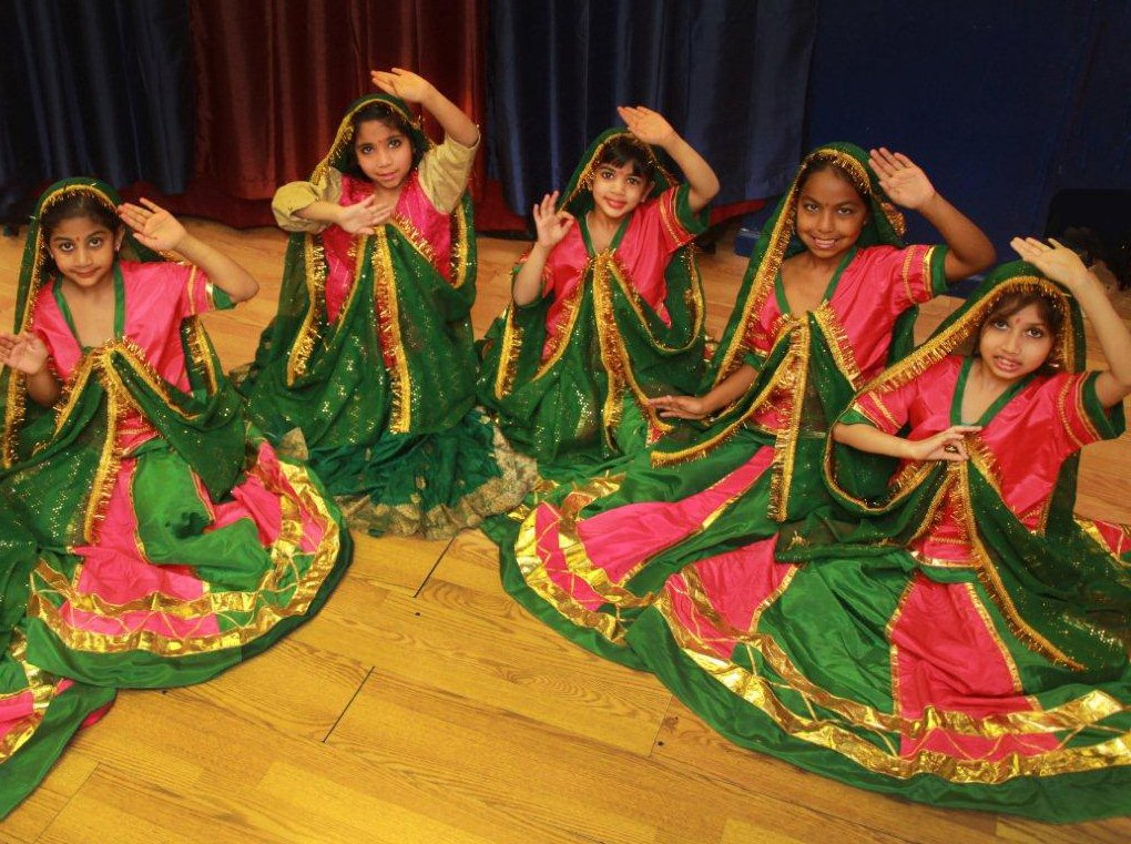 Girls posing for picture in traditional Diwali attire.