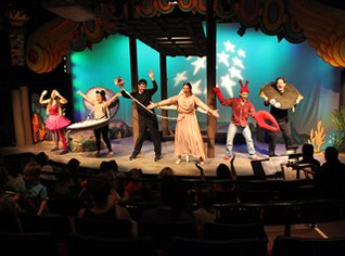 "The cast from the show ""Happy as Clams"" on stage in their costumes."