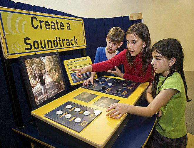 Children creating a soundtrack with exhibit component.
