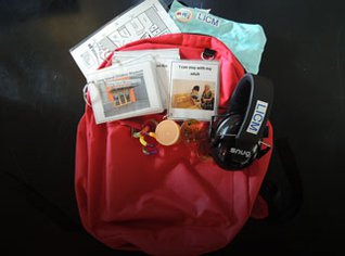 Red backpack with assistive devices.