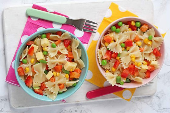 Pasta with peppers, corn and peas.