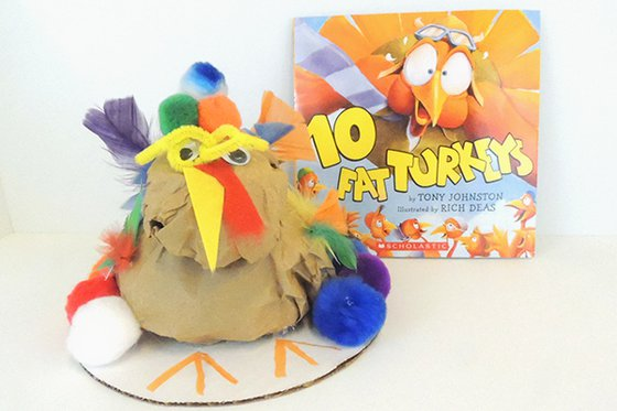 "The book ""10 Fat Turkeys"" with a crafted paper turkey with colorful feathers."