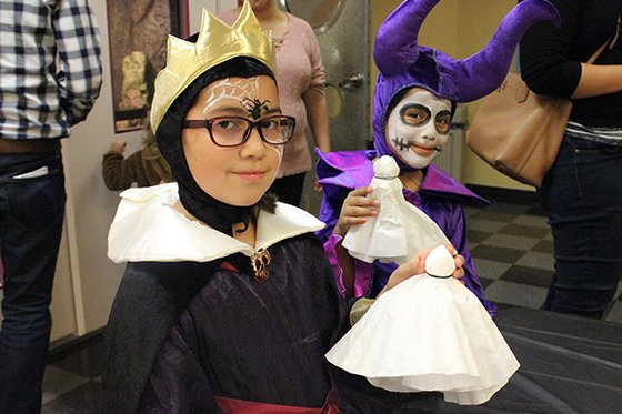 Two children in villain costumes.
