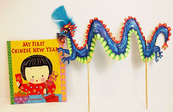 My First Chinese New Year book and a colorful dragon stick puppet.