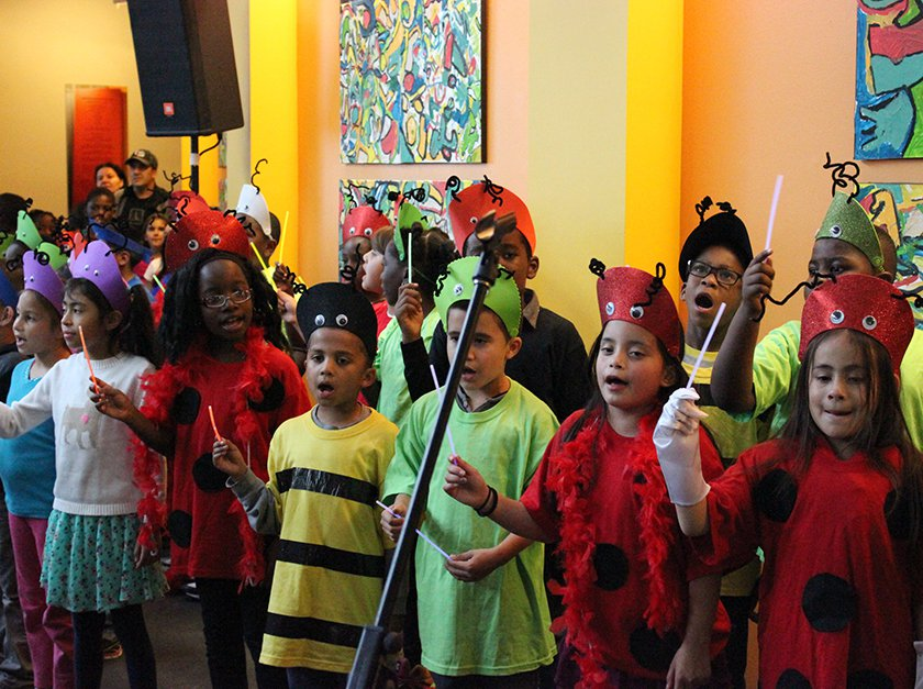 Children dressed up as different types of bugs.