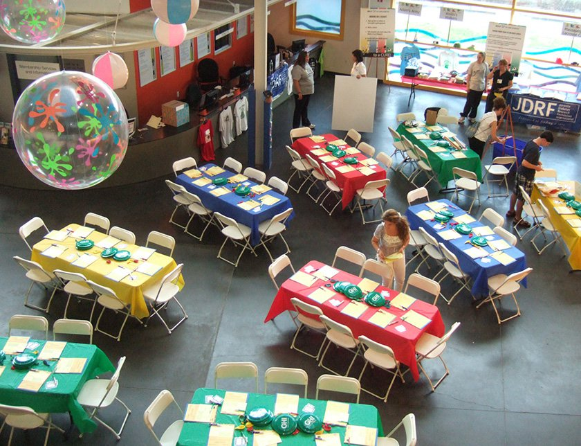 Decorated tables set up in lobby of the Museum.