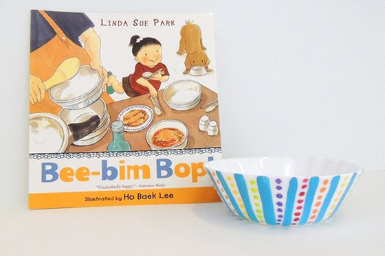 "The children's book ""Bee-bim Bop"" with a small hand-painted bowl."