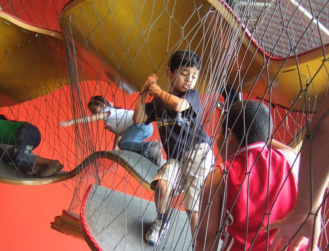 Children traveling through the Museums netted climbing structure.